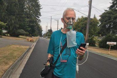 Evans Wilson: Man Completes Seattle Marathon Towing Oxygen Tank