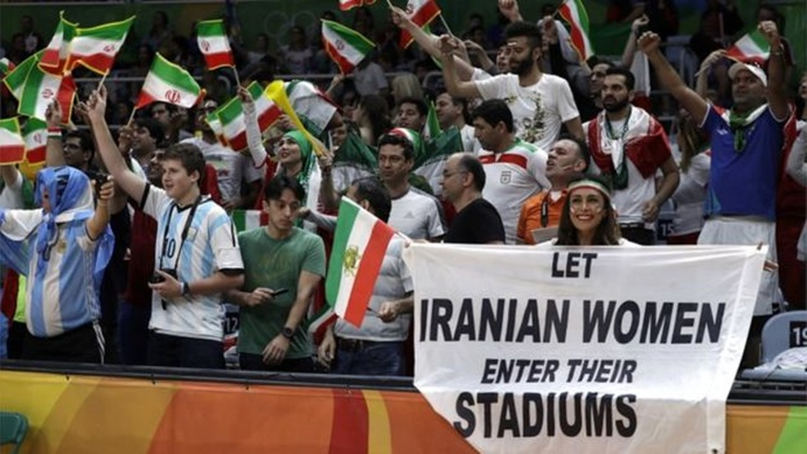 Iranian Women Hold Protest Sign At Olympic Stadium In Brazil